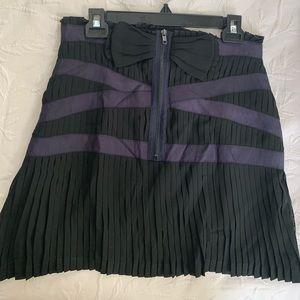 Purple and black pleated mini skirt